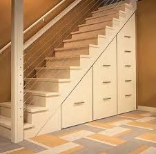Under stair storage on wheels.