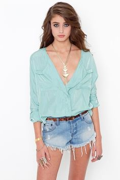 Loose blouse and a pair of denim shorts.