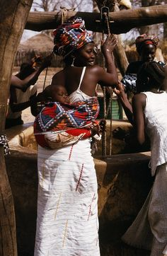 Some of the Moms in Senegal carry their babies tied onto their backs, usually with colourful material...