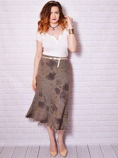 A vintage wool floral midi skirt.  The model on the pictures is size S/36 and 165 cm height. Please check measurements with your own to avoid problems with the size. Make sure you double the measurements where shown (*2):  Label size: L/40 Total lenght: 77 cm / 30.25 inches Waist: 40 cm *2 / 15.75 inches *2 Hips: 45 cm *2 / 17.75 inches *2 Bottom Width: Open  Label: Hobbs Condition: very good vintage Colors: brown beige green Circa: 90s Fabric: 75% Wool, 20% Polyamide...