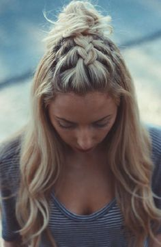 A partial French braid that ends in a top knot.  Lovely!  Originally pinned from  kcdoubletake.com