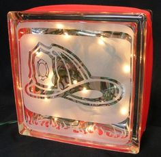 Glass Block with interior lights and ribbon.  Choice of painted or custom vinyl firefighter helmet design.