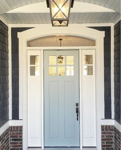 Shingle are painted in Benja… Grey Front Door Paint Color: Benjamin Moore Wedge. Shingle are painted in Benjamin Moore Hale Navy. Millhaven Homes. Painted Exterior Doors, Painted Front Doors, Interior Barn Doors, Exterior Paint, House Front Door, House Doors, Front Porch, Front Door Paint Colors, Paint Colors For Home