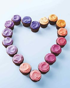 Diminutive chocolate cupcakes get dressed up in an array of color.