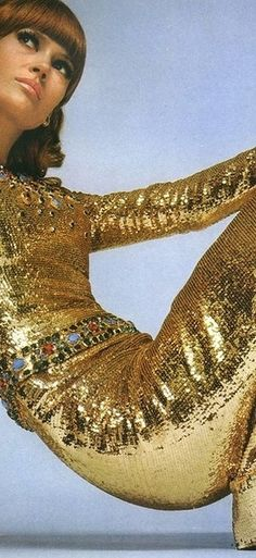 Model wearing metallic gold Yves Saint Laurent gown, photographed by David Bailey for French Vogue. December 1967.