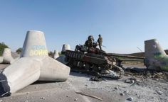 Mariupol, Ukraine: Ukrainian soldiers inspect a tank damaged in recent fighting.