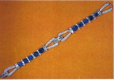 The Queen's Eighteenth Birthday Bracelet - For her eighteenth birthday, in 1944, the King gave Princess Elizabeth this unusual Cartier linked bracelet of square-cut sapphires interspersed with baguette diamonds and ending in diamond loops joined by arcs of baguette diamonds.