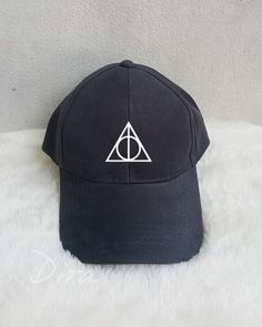 Deathly Hallows baseball cap will be the perfect addition to your OOTD. A Deathly Hallows baseball cap will be the perfect addition to your OOTD. Harry Potter Accessories, Harry Potter Jewelry, Harry Potter Gifts, Harry Potter Outfits, Harry Potter Fashion, Harry Potter Clothing, Harry Potter Shoes, Harry Potter Merchandise, Mode Harry Potter
