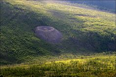 A volcano or a meteor impact: What created this large mysterious Siberian crater?   The Extinction Protocol: 2012 and beyond
