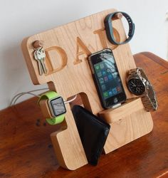 Personalized Phone and Apple Watch Docking Station: A catch-all docking station made to hold your phone and Apple watch as they charge. It can also hold a wallet, keys, glasses, jewelry and more. It's made from Cherry wood and can be personalized with a name or initials.