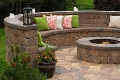 Redefine your backyard with a seating wall and fire pit from Tremron.