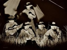 June 1939. Big Horn County, Montana. Quarter Circle U Ranch roundup. Cowhands singing after a day's work...