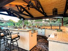 From waterfront estates to rustic retreats, these outdoor areas offer ample appliances and luxury looks.