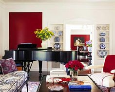 Eclectic Style living room uses color blocking in Garnet Red designed by Martyn Lawrence Bullard