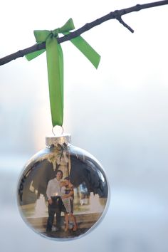 Decorate a whole Christmas tree in photo bulbs. Add a couple each year?