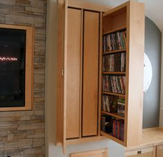 Storage behind the TV, how great! This can be easily done in the bathroom space I am renovating but not with such a big TV of course! Storage Design, Hidden Storage, Tv Cabinets, Bookshelves, Tall Cabinet Storage, Living Room, Modern, Furniture, Space