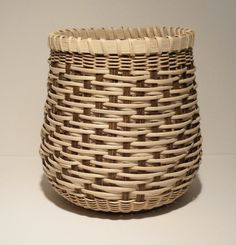 This basket is woven using a 3-1-1-2 twill pattern with 3mm flat oval natural reed. It sits approximately 6 inches high and is 5 inches wide at