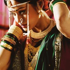 A Maharashtrian bride in traditional gold jewellery by Tanishq and pearl forehead accessory and ambi nath. Big Fat Indian Wedding, Indian Bridal, Saree Jewellery, Gold Jewellery, Wedding Photography India, Indian Fashion, Bridal Jewelry, Bride, Beauty