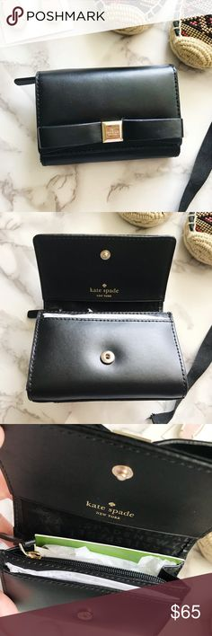 """Kate Spade Leather Bow Wallet Kate Spade black leather compact wallet with tonal stitching, gold-tone hardware, woven logo interior lining, bow adornment at front panel and snap closure.   L 4.25"""", W 1"""", H 3""""  New with tags kate spade Accessories Key & Card Holders"""