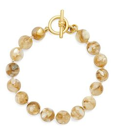 Brooks Brothers Gold Wash Mother-of-Pearl Single Row Bracelet Detailshttp://www.brooksbrothers.com/Gold-Wash-Mother-of-Pearl-Single-Row-Bracelet/WA00094,default,pd.html ITEM# WA00094