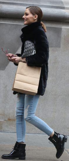 Who made Olivia Palermo's black patent boots, jacket, and print handbag?