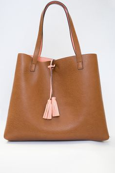 87b73970527c Gorgeous salmon and brown reversible large tote with a detachable change  purse and a tassel accent. Magnetic closure at the top.    We can monogra