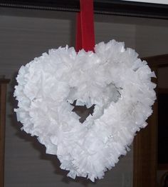 Recycled wreath tutorial uses wire hanger and plastic bags. Could make different shapes and then decorate.
