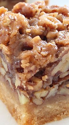 Maple Pecan Squares ~ Thanks to butter, the squares have a flaky, sweet crust contrasted by a maple-coated, crunchy pecan filling.