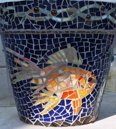 Mosaic koi fish flower pot blue and gold. $250.00, via Etsy.