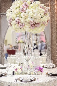 Glam and luxe wedding table setting from SAL floral design It could give the illusion of height to a lower-ceiling reception hall.