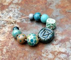 Hand formed ceramic heart and gem beads in blues… Gaea.cc Ceramic Bead and Art Studio Blog: 999 Apparently.