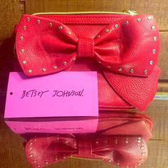 Betsey Johnson top zip bow regard Red. Never used just sits in my closet. Absolutely nothing wrong with it. No rips or stains. Smoke free. NO TRADES. Bags