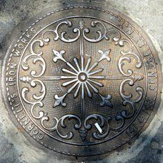 Cornell's Iron Works manhole cover