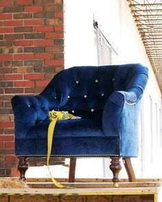 """""""Morton"""" Tufted Chair by Old Hickory Tannery at Horchow. two of these instead of a foot board or bench"""