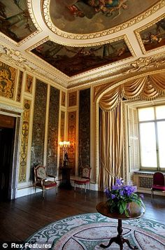 Highclere Castle, West Berkshire, England. The Music room. The Baroque ceiling was painted by Francis Hayman in the 1730s and the walls are hung with 16th century Italian embroideries.