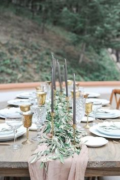 27 a dusty pink table runner with olive leaves and eucalyptus and grey candles in gold candle holders - Weddingomania
