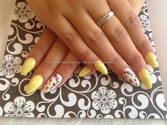 Acrylic+nails+with+yellow+gelish+gel+polish+white+gelish+gel+polish+on+ring+fingers+with+free+hand+nail+art