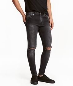 Black washed out. 5-pocket, low-rise jeans in washed stretch denim. Heavily distressed details, zip fly, and skinny legs.