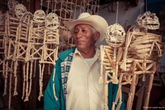 Miguel Ramirez Perez and his skeletons made of straw and chuspata (a variety of bulrush). All materials found on Lake Patzcuaro's lakeshore.