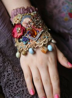 Romantic wrist wrap is made of antique and vintage textiles- antique linen with slightly torn, raw edges, hand dyed and painted, antique laces.