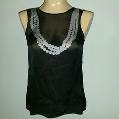 Banana Republic black silky top❤ Black with gray silk top, ties in back. 100% silk. Size xs Banana Republic Tops Blouses
