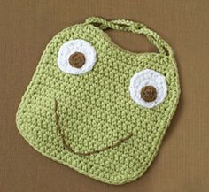 Frog Bib :: Free Crochet Frog Patterns! Hop to it!  I'm going to change the pattern into a pot holder for my grandma- she loves frogs!