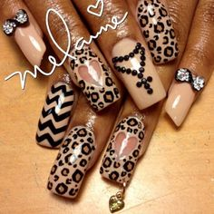 Pierced leopard love nails by @nailcandii
