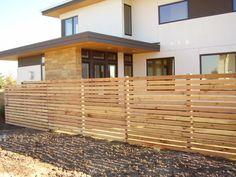 I totally love this horizontal cedar fence