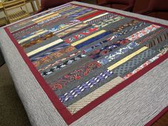 Tie Quilt - love the burgundy border and gray sides and backing. Also used gray between each tie.