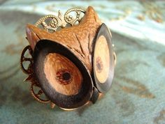super cool owl ring carved from wood, reminds me of The Watchmen comic