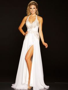 Halter top pageant dresses are often favored at Miss America and the Mac Duggal evening gown 6350P is a beautiful silk gown with low cut halter neckline lined with tons of rhinestones, a fitted beaded empire waist, hips that have hand sewn Swarovski crystal pattern, and a thigh high split in the skirt.