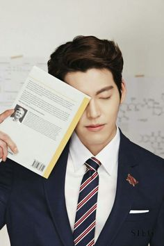 KIM WOO BIN makes me want to read the book he's holding