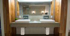 Concrete countertops in a bathroom. Raised sinks. Pretty clean lines.