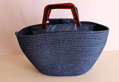 HANDMADE BASKET BAG, MONOCHROME BASKET BAG BASKETRY HANDMADE BOHO BAG THIS BASKET BAG IS MADE WITH ROPE AND SOFT DENIM COTTON FABRIC VERY CLASSY AND SPECIAL VERY SIMILAR TECNIQUE TO HANDMADE BASKETS THAT WERE MADE IN THE VILLAGES IN MY COUNTRY, CYPRUS THE MONOCHROME DENIM MAKES IT VERY CHIC AND CLASSY AMBER PLASTIC HANDLES FOR EXTRA VINTAGE LOOK EXTRA DENIM INSERT WITH ZIP FOR CLOSURE READY FOR YOUR EVENING OUTTINGS, FOR SHOPPING, FOR THE MARKET OR FOR A TRENDY SPECIAL ETHNIC LOOK OF A MO...